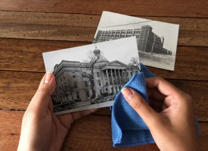 Wiping old photos with a microfiber cloth